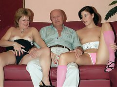 Curvy mature Martha joins a young woman on the couch for an explicit threesome movie