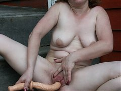 Explicit live cam show with a mature woman fellating and stuffing her pussy with a dildo